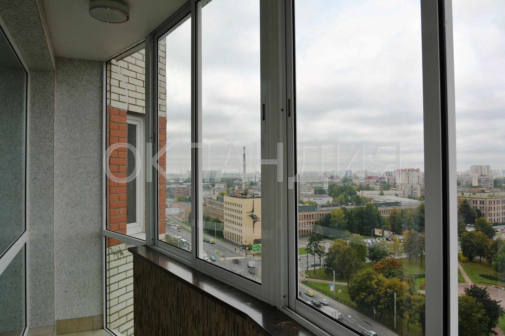 Остекление балкона раздвижными окнами с отделкой.