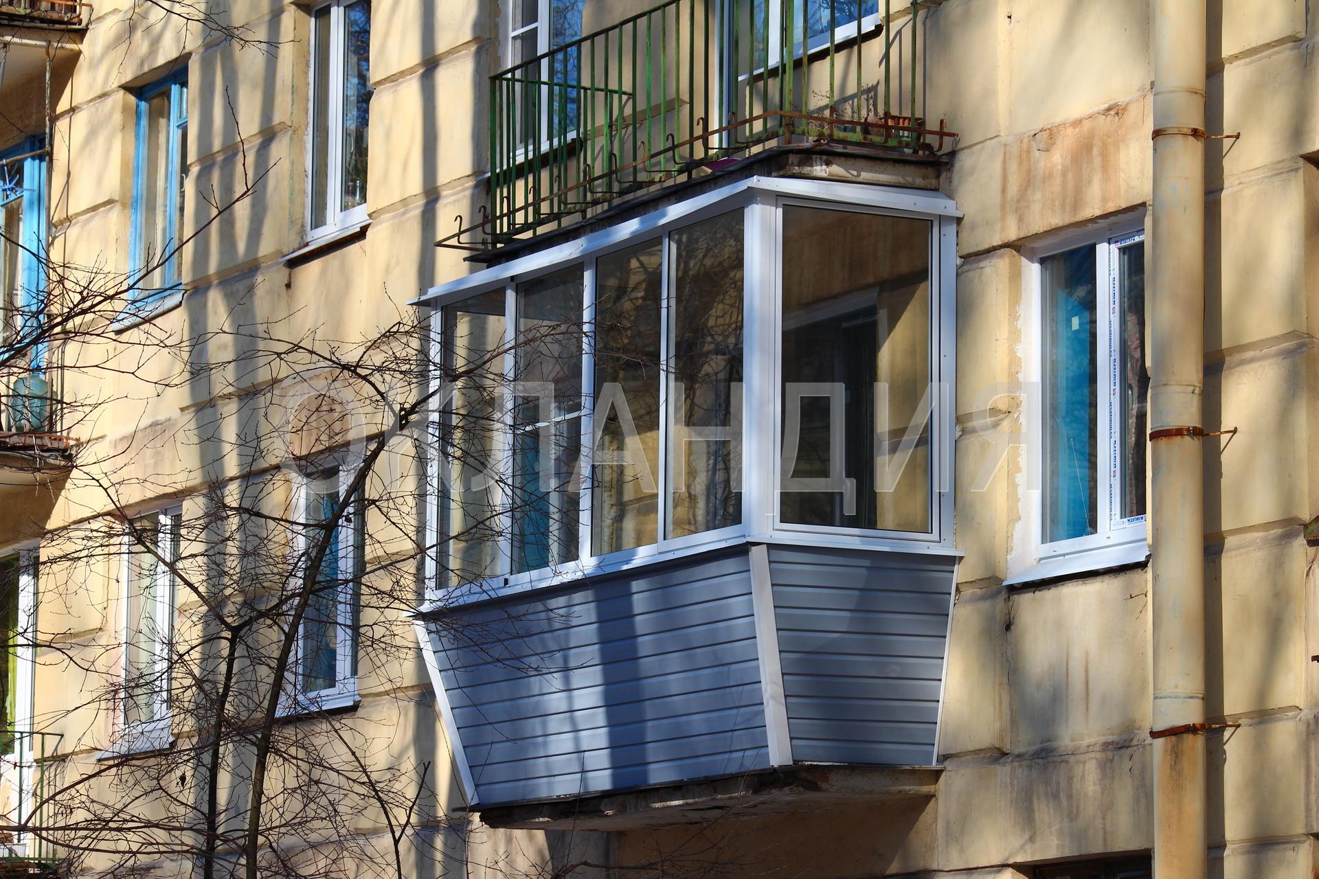 Остекление балкона с выносом алюминиевых рам наружу за перил.