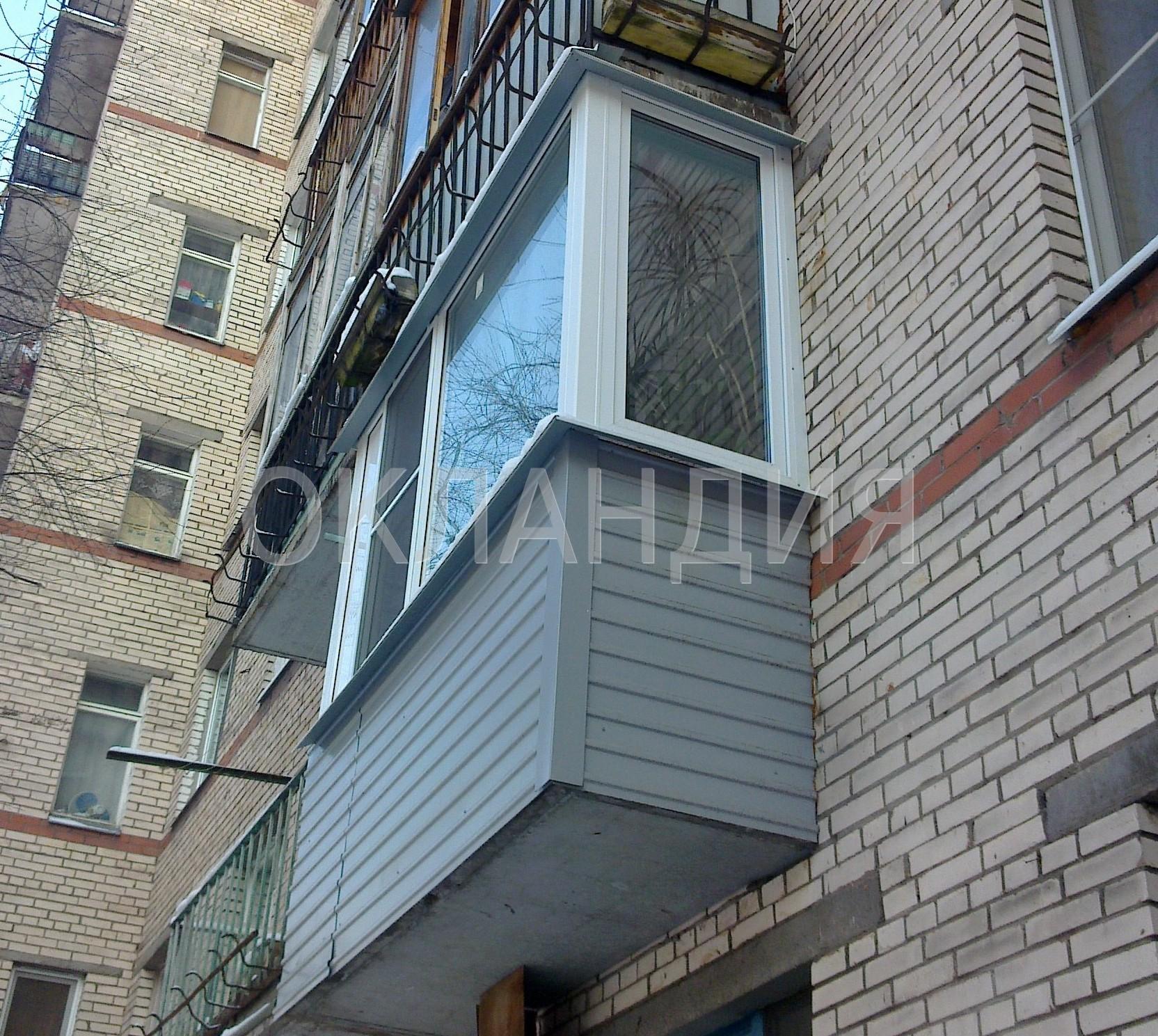 Остекление балкона в кирпичном 9-ти этажном доме.